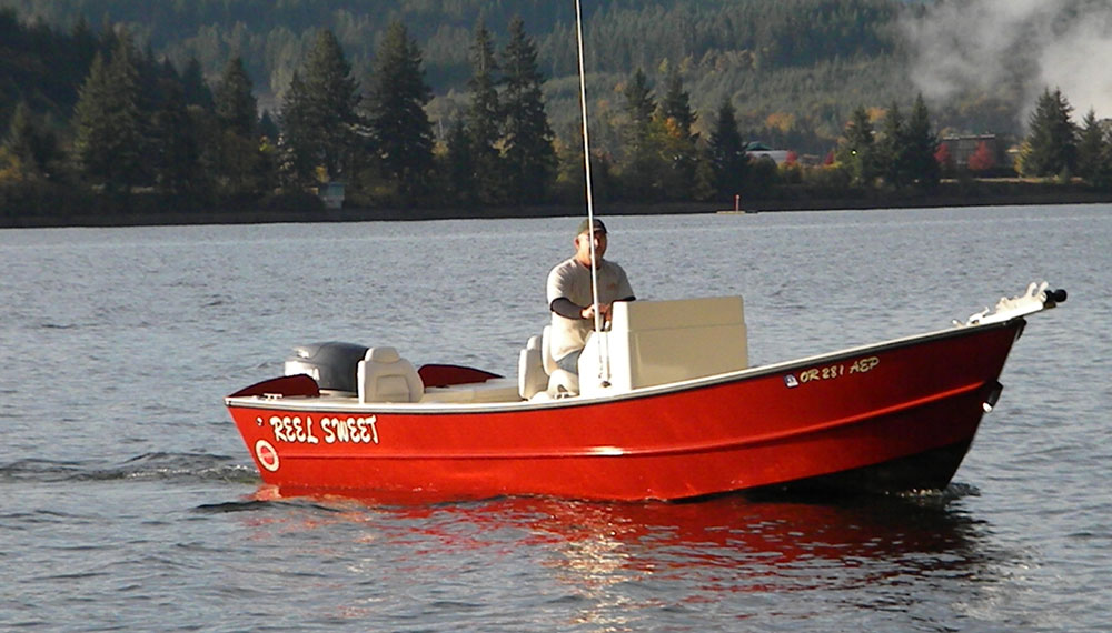 Red 21 foot widebody Tolman Skiff